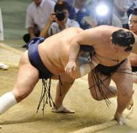 Powerful push: Ozeki Kotomitsuki (left) drives fourth-ranked maegashira Goeido out of the ring on the 12th day of the Nagoya Grand Sumo Tournament at Aichi Prefectural Gymnasium on Thursday. Kotomitsuki is 9-3. | KYODO PHOTO