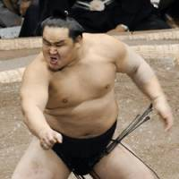 Guess who's back: Asashoryu psyches himself up before his bout with Kisenosato at the New Year Grand Sumo Tournament on Sunday. | KYODO PHOTO