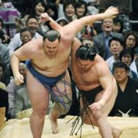 Another one bites the dust: Hakuho sends Baruto on his way at the Spring Grand Sumo Tournament in Osaka on Sunday.   KYODO PHOTO