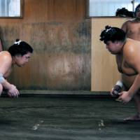 Ready, steady ... : Sumotori face off at a morning practice session, which is easier to witness than you might think.   HARUNA MIYASHITA PHOTO