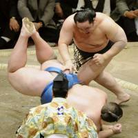 No challenge: Asashoryu throws Baruto to the dirt surface during the New Year Grand Sumo Tournament. | KYODO PHOTO