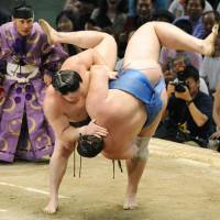 Perfect, perfect, perfect: Hakuho gets the better of Baruto on the final day of the Nagoya Grand Sumo Tournament on Sunday.   KYODO PHOTO