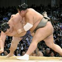 Show of force: Toyonoshima (right) overpowers Kaio at the Kyushu Grand Sumo Tournament on Saturday. | KYODO PHOTO