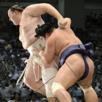 Timber!: Myogiryu (right) shoves Baruto out of the ring at the Nagoya Grand Sumo Tournament on Sunday. | KYODO
