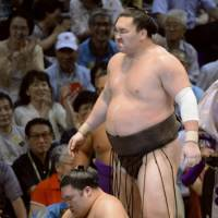 Avenged: Hakuho stands over Goeido after beating him at the Nagoya Grand Sumo Tournament on Monday.   KYODO