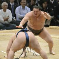Impressive: Yokozuna Hakuho picks up his 10th victory in as many matches at the Kyushu Grand Sumo Tournament on Tuesday. | KYODO