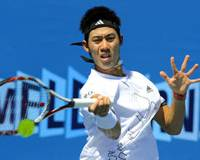Going home early: Kei Nishikori plays a shot from Austria's Juergen Melzer in their first-round match at the Australian Open on Tuesday. Melzer won 7-5, 6-2, 6-1. | AP PHOTO