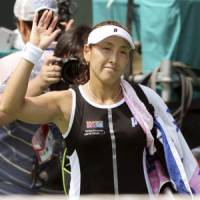 Bitter end: Ai Sugiyama waves after retiring from her first-round singles match on Monday. | AP PHOTO
