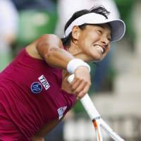 Three and out: Kimiko Date Krumm hits a shot against Francesca Schiavone during their match at the Pan Pacific Open on Wednesday. Date Krumm lost 6-3, 6-3. | KYODO PHOTO