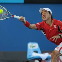 Comeback kid: Kei Nishikori hits a shot during his 3-6, 1-6, 6-4, 6-1, 6-1 win over Matthew Ebden in the second round of the Australian Open on Thursday. | AP
