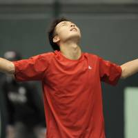 All systems Go: Go Soeda reacts after beating Croatia's Ivan Dodig 6-7 (3-7), 3-6, 6-4, 6-3, 7-5 in their Davis Cup World Group first-round tie in Miki, Hyogo Pref., on Friday. | KYODO