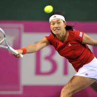 Date with destiny: Kimiko Date-Krumm hits a shot during her Fed Cup match against Belgium's Tamaryn Hendler on Saturday. Date-Krumm won 6-1, 6-4 as Japan took a 2-0 lead over the Belgians in their World Group playoff. | AFP-JIJI