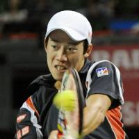 Staying aggressive: Kei Nishikori plays a return against Tommy Robredo in the Japan Open on Thursday in Tokyo. Nishikori, the eighth seed, beat the Spaniard 5-7, 6-1, 6-0 to reach the quarterfinals. | KYODO
