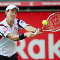 Championship determination: Kei Nishikori captures his second career title on Sunday at the Japan Open.   KYODO