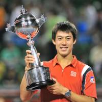 First come, first serve: Kei Nishikori holds his trophy after becoming the first Japanese winner in the 41-year history of the Japan Open on Sunday.   AFP-JIJI