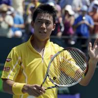 Miami vice: Kei Nishikori waves after beating Xavier Malisse 6-2, 7-5 in the third round of the Sony Open on Sunday in Key Biscayne, Florida.   AP