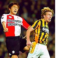 Shinji Ono of Feyenoord competes for the ball against a Vitesse Arnhem player during their Dutch League game in Rotterdam, the Netherlands.