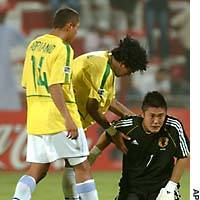 Brazil's Daniel tries to comfort Japan goalkeeper Eiji Kawashima after Brazil beat Japan 5-1 in the quarterfinals of the World Youth Cup on Friday.