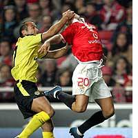 Rui Oscar of Beira-Mar grabs Benfica striker Simao Sabrosa by the face during their Portuguese League match Saturday at Lisbon's Luz Stadium. Beira-Mar won 2-0 thanks to a pair of goals from Tanque Silva.