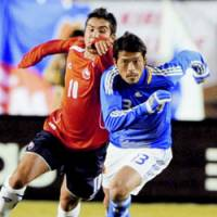 Japan midfielder Keita Suzuki (right) dribbles the ball in a friendly match against Chile at Tokyo's National Stadium on Saturday. The teams played to a a 0-0 draw. | KYODO PHOTO
