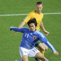 Looking forward: Japan forward Keiji Tamada (11) dribbles during the first half against Australia in the World Cup Asian zone qualifier at International Stadium Yokohama. The game ended in a scoreless draw. | KYODO PHOTO