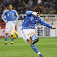 Winning form: Japan midfielder Shunsuke Nakamura fires a shot on goal in the 47th minute against Bahrain on Saturday in a World Cup qualifier at Saitama Stadium 2002. Nakamura scored on the play in Japan's 1-0 victory. | KYODO PHOTO