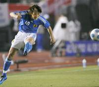 Midfield maestro: Japan midfielder Shunsuke Nakamura kicks a centering pass during the Kirin Cup against Belgium on Sunday at Tokyo's National Stadium. Japan won 4-0 and clinched the Kirin Cup championship for the third straight year and 10th overall time. | KYODO PHOTO