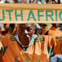 Festive atmosphere: Fans revel in the excitement of the 2010 World Cup's opening ceremony on Friday in Johannesburg. | KYODO PHOTOS