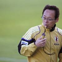 Looking for answers: Coach Takeshi Okada is running out of time to get Japan sorted out before its World Cup campaign begins on Monday against Cameroon. | AP PHOTO