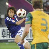 Pull the trigger: Tadanari Lee volleys Japan's 109th-minute winner in the Asian Cup final against Australia in Doha on Saturday. | KYODO PHOTO