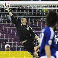 For safe keeping: Japan goalkeeper Eiji Kawashima leaps to make a save against Australia during the Asian Cup final in Doha. Japan won 1-0. | KYODO PHOTO