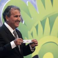 Luck of the draw: Former Japan manager Zico picks Japan's ticket at the preliminary draw for the 2014 World Cup on Saturday in Rio de Janeiro. | AP