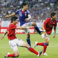 Fully recovered: Japan's Shinji Kagawa scores the first of his two goals against South Korea on Wednesday at Sapporo Dome. Japan won 3-0. | KYODO