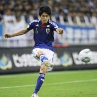Up for grabs: Japan defender Atsuto Uchida launches a cross in the second half against North Korea in Friday's World Cup qualifier game at Saitama Stadium 2002.
