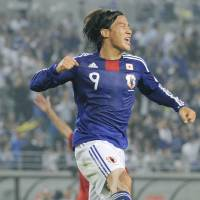 That winning feeling: Japan's Shinji Okazaki and his teammates had opportunities to celebrate all evening in an 8-0 victory over Tajikistan in a  World Cup qualifier in Osaka. | KYODO