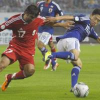 Best foot forward: Shinji Kagawa (right) is hoping to use his two-goal performance in Japan's 8-0 win over Tajikistan on Tuesday as a springboard to success with club side Borussia Dortmund. | KYODO