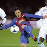 Bittersweet triumph: Barcelona's David Villa attempts a shot against Al Sadd during their semifinal match at the Club World Cup on Thursday in Yokohama. Barca won 4-0, but Villa suffered a broken tibia on the play. | KYODO PHOTO