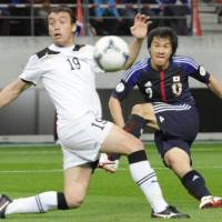 Off target: Shinji Okazaki attempts a shot during Japan's match against Uzbekistan on Wednesday. Uzbekistan won 1-0. | KYODO