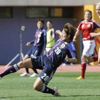 Deft touch: Nadeshiko Japan's Yuika Sugasawa scores in the 52nd minute against Denmark in Group B action at the Algarve Cup on Friday in Parchal, Portugal. Japan won 2-0. | KYODO