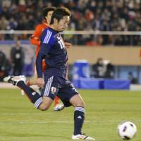 See you in London: Hiroshi Kiyotake scores Japan's second goal against Bahrain on Wednesday at National Stadium. | KYODO