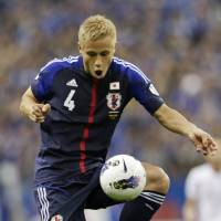 Hats off: Keisuke Honda scored three goals in Japan's 6-0 rout of Jordan in their World Cup qualifier on Friday night. | AP