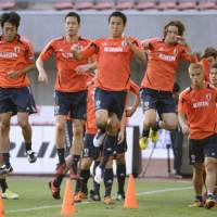 Jump to it: Japan's players train at Niigata's Big Swan Stadium on Wednesday ahead of Thursday's friendly against the United Arab Emirates. | KYODO