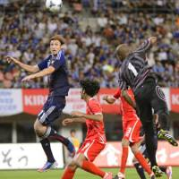 Better late than never: Mike Havenaar scores on a header during the second half of Japan's 1-0 victory against over United Arab Emirates. | KYODO