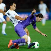 Global takeover: Mihael Mikic (front) and Sanfrecce Hiroshima take on Egypt's Al-Ahly in the quarterfinals of the Club World Cup on Sunday. | AP