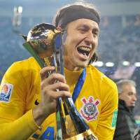 Top of the world: Corinthians goalkeeper Cassio celebrates after beating Chelsea 1-0 in Sunday's Club World Cup final. | AFP-JIJI