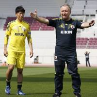 Laying the groundwork: National team manager Alberto Zaccheroni (right) gives instructions at Japan's training session in Doha on Sunday as attacking midfielder Shinji Kagawa looks on. | KYODO