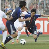 Celebrations on hold: Shinji Kagawa (10) takes a tumble during Japan's 2-1 World Cup-qualifying defeat to Jordan in Amman on Tuesday.  | KYODO