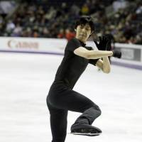 Getting ready: Yuzuru Hanyu performs during a practice session for the ISU World Figure Skating Championships on Monday in London, Ontario.  | AP