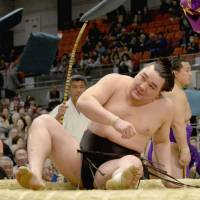 Down but not out: Harumafuji picks up his first loss of the Spring Grand Sumo Tournament on Tuesday in Osaka, falling against Takayasu.  | KYODO