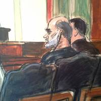 Spokesman listens: In this courtroom drawing, Osama bin Laden's son-in-law Sulaiman Abu Ghaith listens to a translator as his attorney speaks at a federal court in New York on Friday. | AP